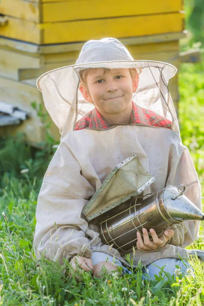 young-beekeeper-with-hives